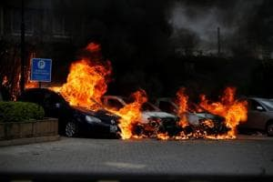 Cars are seen on fire at the scene where explosions and gunshots were heard at the Dusit hotel compound, in Nairobi, Kenya.