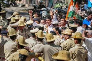 Congress workers protest in front of BJP MLA Ashwath Narayana