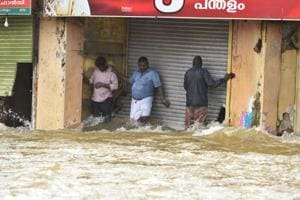 People who were stranded because flood waters at Panadala, in district Pathanamthitta of Kerala in August 2018.