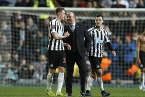 Newcastle United manager Rafael Benitez, center, speaks to Sean Longstaff after the Emirates FA Cup third round replay soccer match against Blackburn