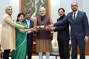Prime Minister Narendra Modi receives the first-ever Philip Kotler Presidential award, in New Delhi on Monday.