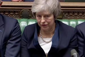 Prime Minister Theresa May sits down in Parliament after the vote on May