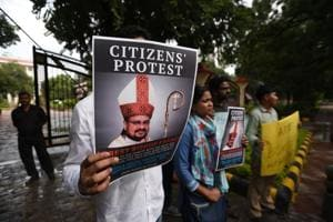People hold a protest against former bishop Franco Mullakkal for his arrest outside the Kerala House, in New Delhi, India, on September 21, 2018.