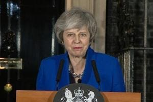 Theresa May wins confidence vote, takes conciliatory approach