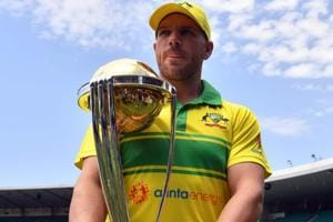 Australian cricket captain Aaron Finch poses with the ICC Cricket World Cup trophy.