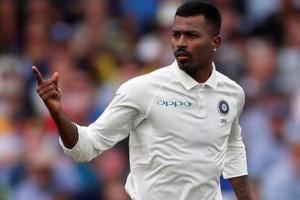 Hardik Pandya celebrates taking the wicket of England