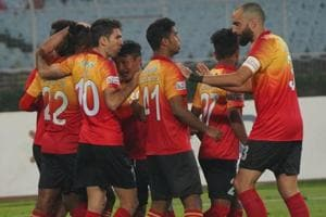 East Bengal players celebrate after scoring against Indian Arrows.