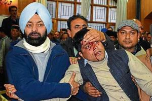 Workers taking a person injured during a scuffle between two factions of Congress at  an event of the party n Shimla on Thursday, January 17, 2019.