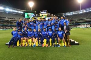 Indian cricket team members pose with the Border–Gavaskar Trophy during their one day international cricket match against Australia in Melbourne, Australia, Friday, Jan. 18, 2019.