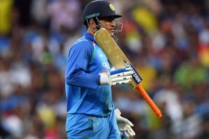 MS Dhoni walks back to the pavilion during the third ODI match against Australia.