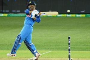 MS Dhoni hits the ball during the third ODI match against Australia.