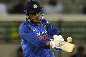 MS Dhoni bats during their one day international cricket match against Australia in Melbourne.