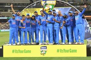 Indian cricket team players pose with the Border Gavaskar Trophy.