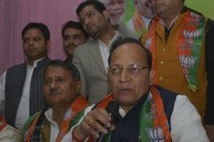 BJP general secretary Arun Singh (C) speaks during a press conference, in Ghaziabad