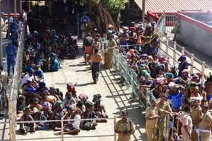 Devotees wait in line to visit the Sabarimala temple in Kerala following the entry of two women on January 2, 2019.