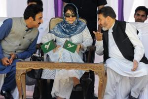 Jammu and Kashmir's then Chief Minister Mehbooba Mufti flanked by Finance Minister Altaf Bukhari (right) and PDP General Secretary Peer Mansoor during a party worker