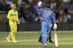 MS Dhoni celebrates hitting the winning runs against Australia.