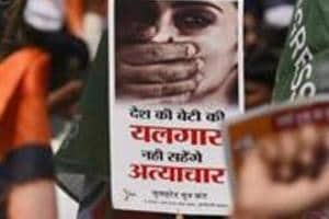 FILE - In this Aug 23, 2013 file photo, Indian activists hold placards demanding rapists be hanged as they protest against the gang rape of a 22-year-old woman photojournalist in Mumbai India. India