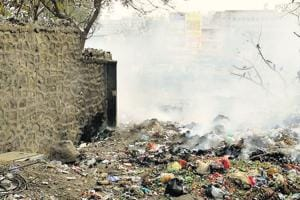 Indiscriminate garbage burning takes place in Wagholi.