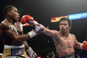 Manny Pacquiao (right) and Adrien Broner during their WBA welterweight world title boxing bout.