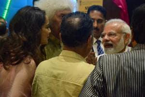 Prime Minister Narendra Modi, santoor maestro Shiv Kumar Sharma and actress Kangana Ranaut at the inauguration of National Museum of Indian Cinema, in Mumbai.