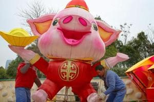 Workers set up a decoration to mark the upcoming Lunar New Year of the Pig in Nantong, China