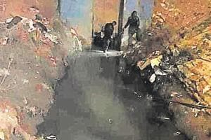 The labourer's body was recovered from the drain after an eight-hour operation.