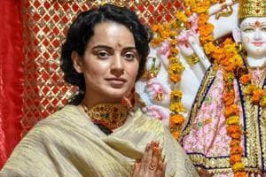 Bollywood actor Kangana Ranaut poses for photos as she pays obeisance at a newly-built temple, in Mandi.