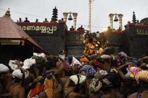 Devotees climb over the holy eighteen golden steps to worship deity of Hindu god Ayyapa at a temple premises in Sabarimala in the southern state of Kerala.