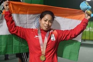 Sanjita Chanu poses with the tricolour for a photo after winning gold in the women