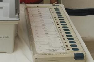 An electoral officer demonstrates the Electronic Voting Machine (EVM) in Patna, Bihar.