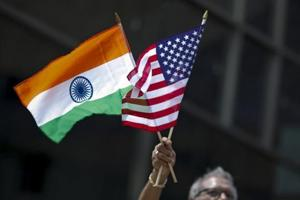 File photo of a man holding the flags of India and the US during India Day Parade  in New York.