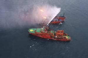 An aerial view from a helicopter shows a rescue vessel during a fire-fighting operation following an accident involving two ships, which caught fire in the Kerch Strait, near the coast of Crimea in this handout photo released by Russian Emergencies Ministry January 22.
