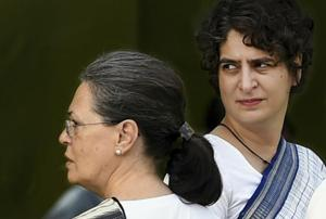 ** FILE PHOTO** New Delhi: In this file photo dated May 21, 2016, Priyanka Gandhi Vadra with her mother Sonia Gandhi after a prayer meeting of former Prime Minister Rajiv Gandhi