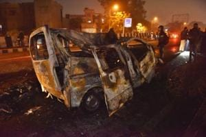 The charred remains of the Maruti Omni van that went up in flames in east Delhi's Anand Vihar after being hit by a Ford Ecosport on the other side of the road, Wednesday, January 23, 2019.