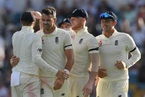 James Anderson of England is congratulated by team-mates after taking the wicket of Roston Chase.