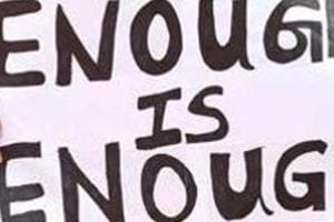 Activists hold placards to protest against incidents of sexual abuse.