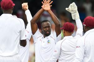 Kemar Roach (C) of West Indies celebrates the dismissal of Ben Stokes of England during day 2 of the 1st Test between West Indies and England.
