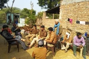 Police advising villagers against the auction programme.
