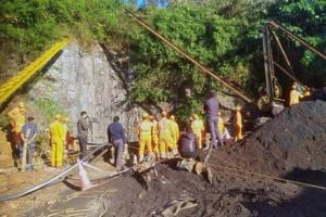 Rescuers work at the site of a coal mine that collapsed in Ksan, in Meghalaya.