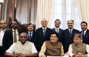 Piyush Goyal with members of his budget 2019 team at North Block in New Delhi.
