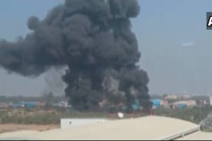 Smoke billows from the wreckage of a Mirage 2000  aircraft which crashed in Bengaluru Friday morning.