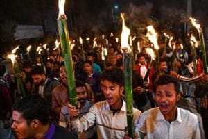 Activists of All Assam Students Union (AASU) along with 30 indigenous organizations take out a torch light procession to protest against the Citizenship Amendment bill in Guwahati on January 31.