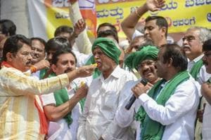 BJP leader offer sweets to farmers during celebrations for the Union Budget announcements, in Bengaluru on February 2.
