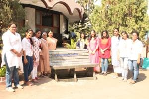 Students and teachers of St Teresa's Institute of Education, Santacruz stand besides the bench made from used Tetra Pak cartons.