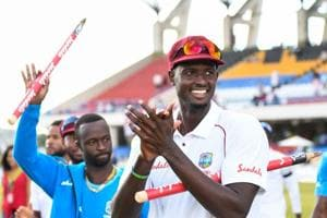 Jason Holder (R) of West Indies celebrates winning on day 3 of the 2nd Test between West Indies and England at Vivian Richards Cricket Stadium in North Sound, Antigua and Barbuda, on February 02, 2019