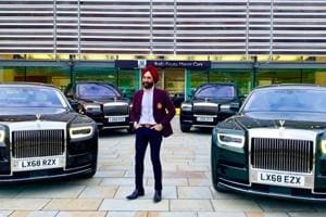Reuben Singh standing next to four of his six new  Roll-Royce cars.