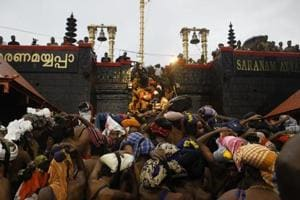 Devotees climb over the holy eighteen golden steps to worship diety of Hindu god Ayyapa at a temple premises in Sabarimala in the southern state of Kerala on November 16.