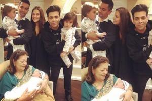 Neha Dhupia and Angad Bedi with their daughter Mehr and Karan Johar's twins and mother Hiroo Johar.