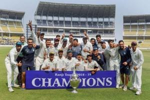 Vidarbha team poses with the trophy after defeating Saurashtra in the final match of the Ranji Trophy.